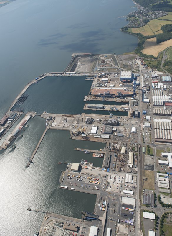Oblique aerial view of the building of the aircraft carrier, HMS Elizabeth at Rosyth Dockyard, looking WNW.
