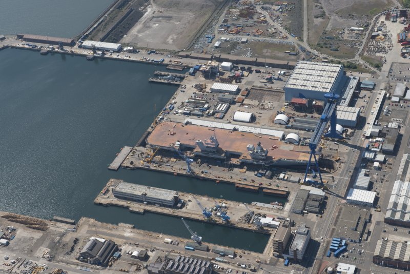 Oblique aerial view of the building of the aircraft carrier, HMS Elizabeth at Rosyth Dockyard, looking W.