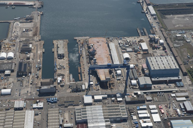Oblique aerial view of the building of the aircraft carrier, HMS Elizabeth at Rosyth Dockyard, looking SW.