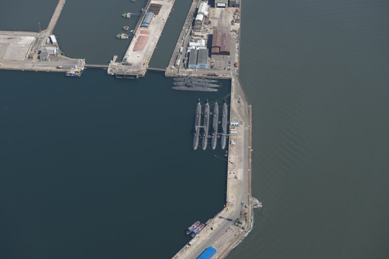 Oblique aerial view of the submarines in the main basin of Rosyth Dockyard, looking SE.