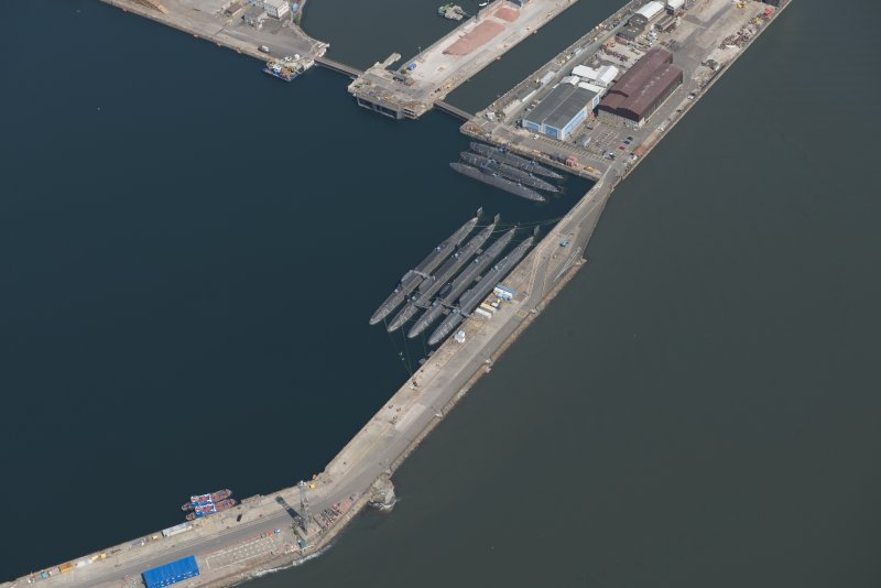 Oblique aerial view of the submarines in the main basin of Rosyth Dockyard, looking NE.