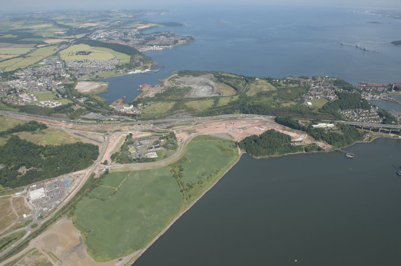Oblique aerial view of the roadworks on the north bank of the River Forth leading to the Queensferry Crossing, looking ENE.