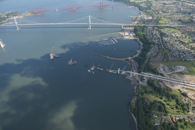 Oblique aerial view of the construction of the Queensferry Crossing and Port Edgar, looking E.