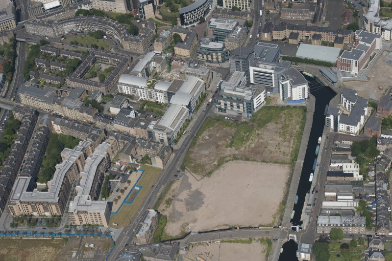 General oblique aerial view of Fountainbridge, Union Canal, Lochrin Basin and Edinburgh Quay, looking NE.