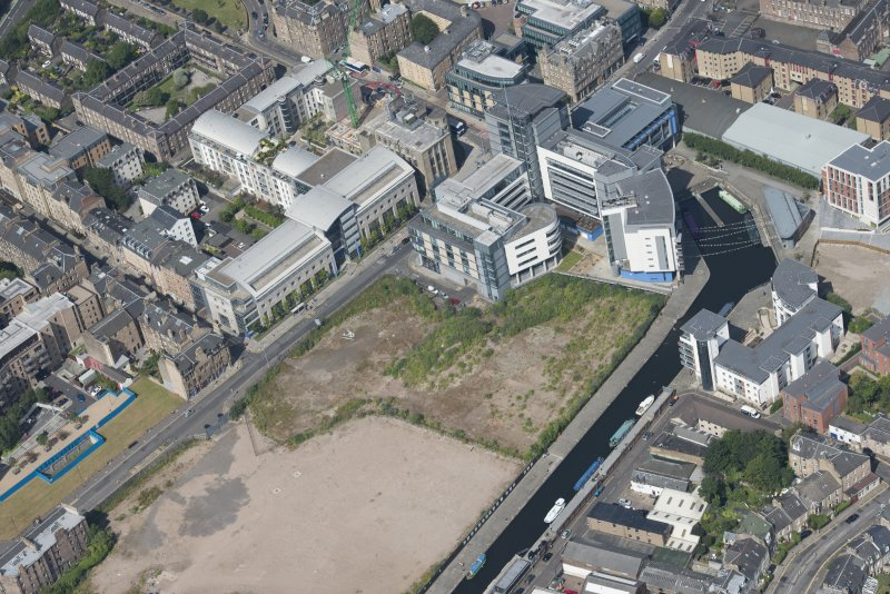 General oblique aerial view of Fountainbridge, Union Canal, Lochrin Basin and Edinburgh Quay, looking NNE.