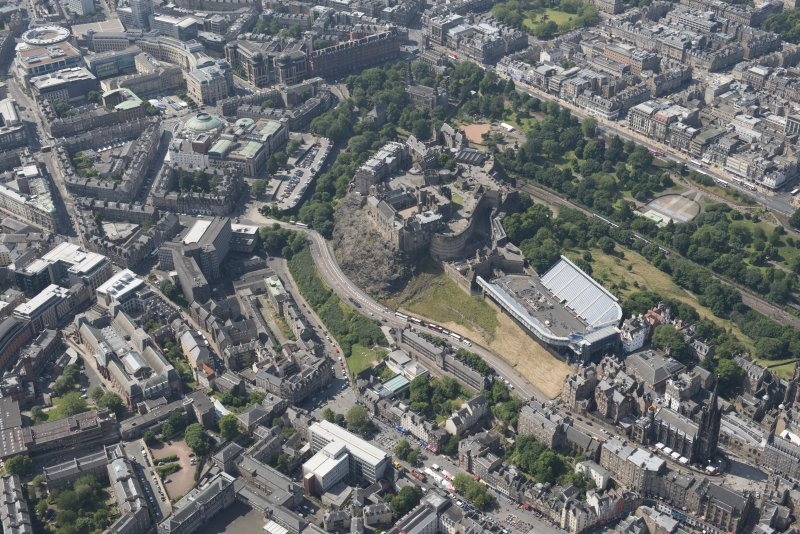 Oblique aerial view of Edinburgh Castle and Esplanade, looking WNW.