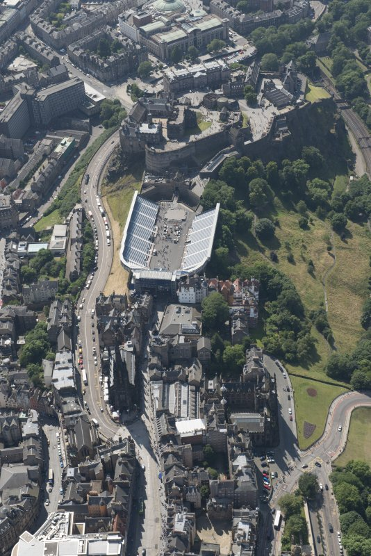 Oblique aerial view of Edinburgh Castle and Esplanade, looking WSW.