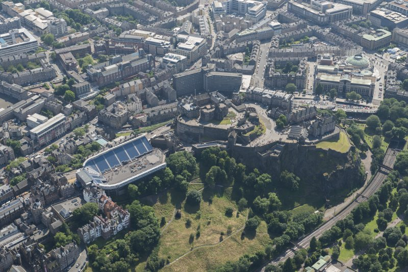 Oblique aerial view of Edinburgh Castle and Esplanade, looking S.