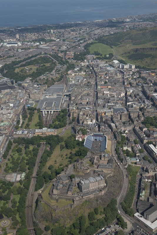 General oblique aerial view of Edinburgh Old Town, Edinburgh Castle and Waverley Station, looking ENE.