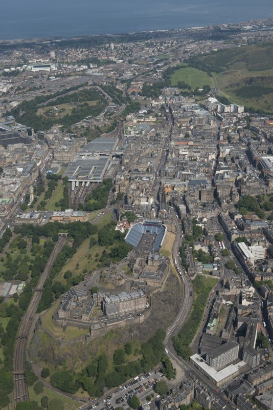 General oblique aerial view of Edinburgh Old Town, Edinburgh Castle and Waverley Station, looking NE.