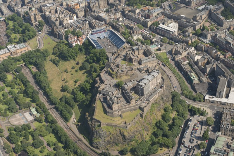 Oblique aerial view of Edinburgh Castle and Esplanade, looking ESE.