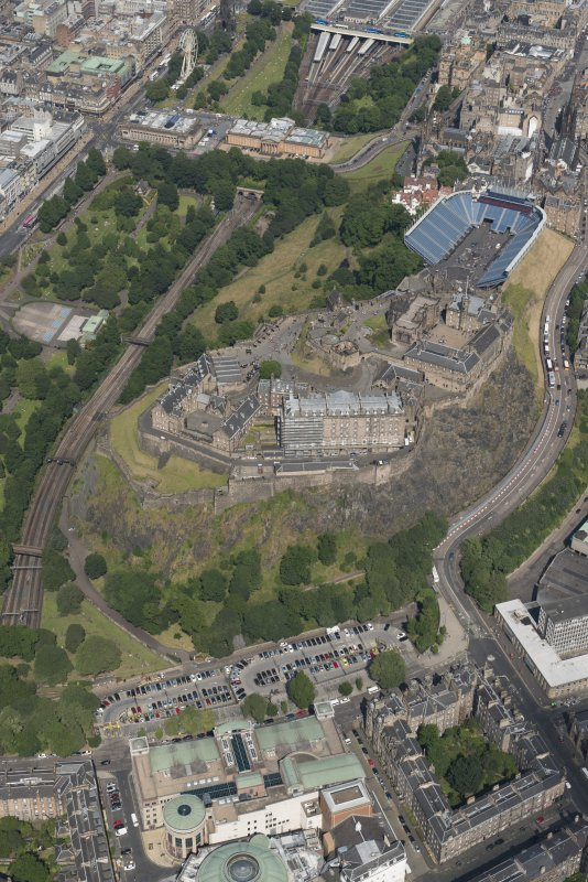 Oblique aerial view of Edinburgh Castle and Esplanade, looking NE.