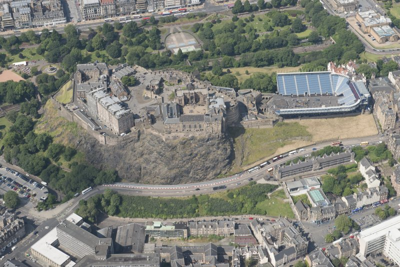 Oblique aerial view of Edinburgh Castle and Esplanade, looking N.