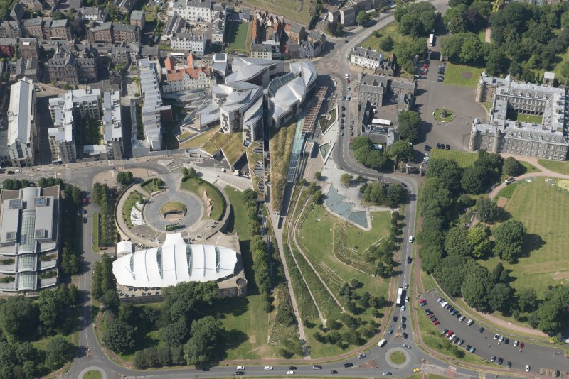 Oblique aerial view of Our Dynamic Earth and Scottish Parliament, looking NW.