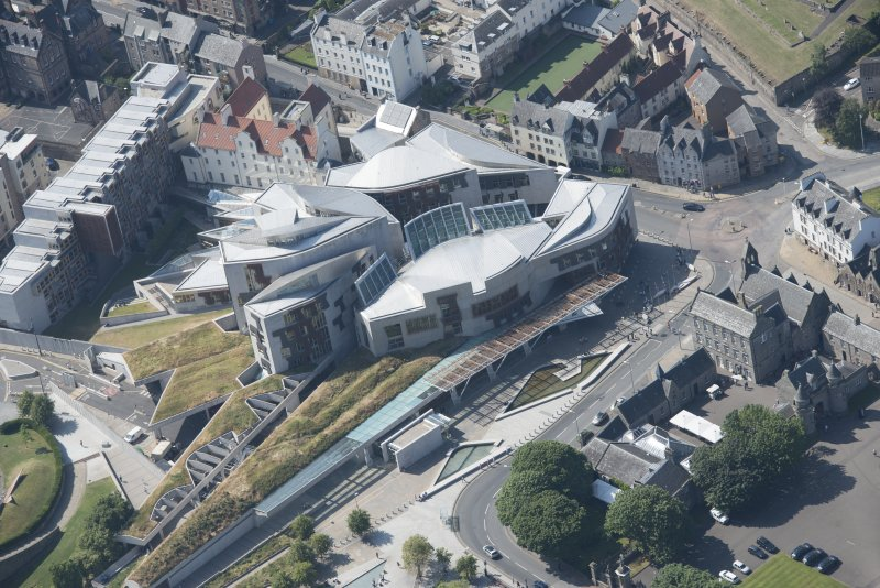 Oblique aerial view of the Scottish Parliament, looking WNW.