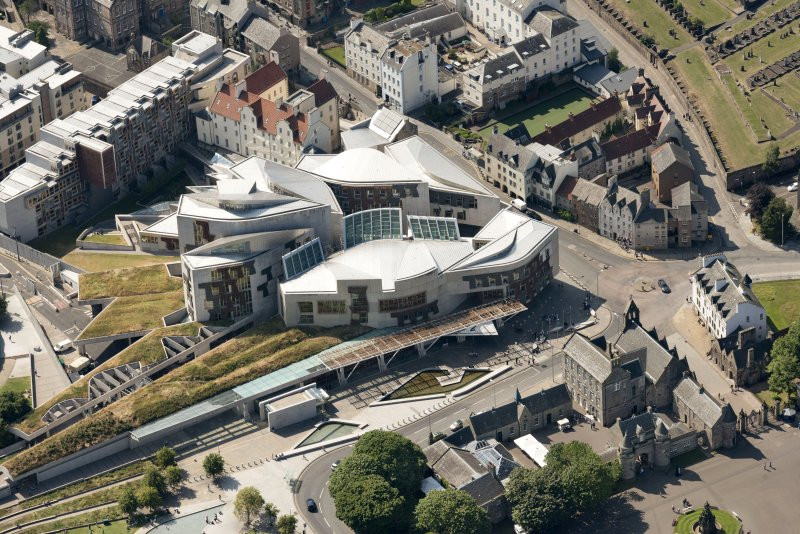 Oblique aerial view of the Scottish Parliament, looking W.