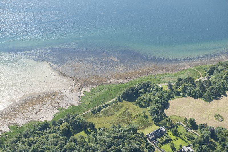 Oblique aerial view of Ardpatrick centred on the intertidal wall, looking SE.