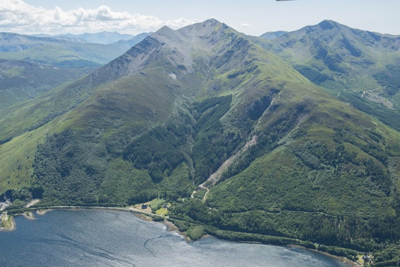 General oblique aerial view of Ballachulish centred on the Episcopal Church of St John, looking SW.