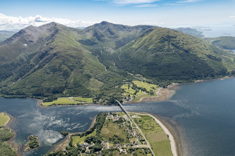 General oblique aerial view of Ballachulish centred on the Ballachulish Bridge, looking SW.