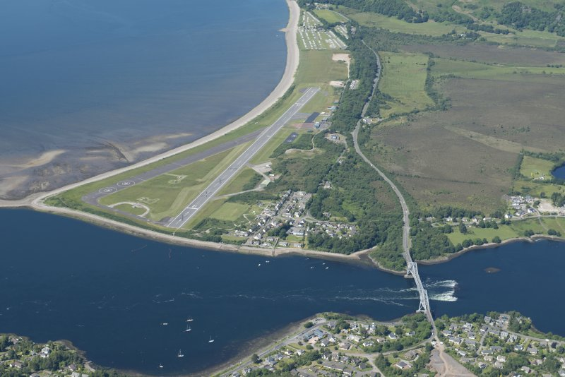 Oblique aerial view of Connel Airfield, looking NW.