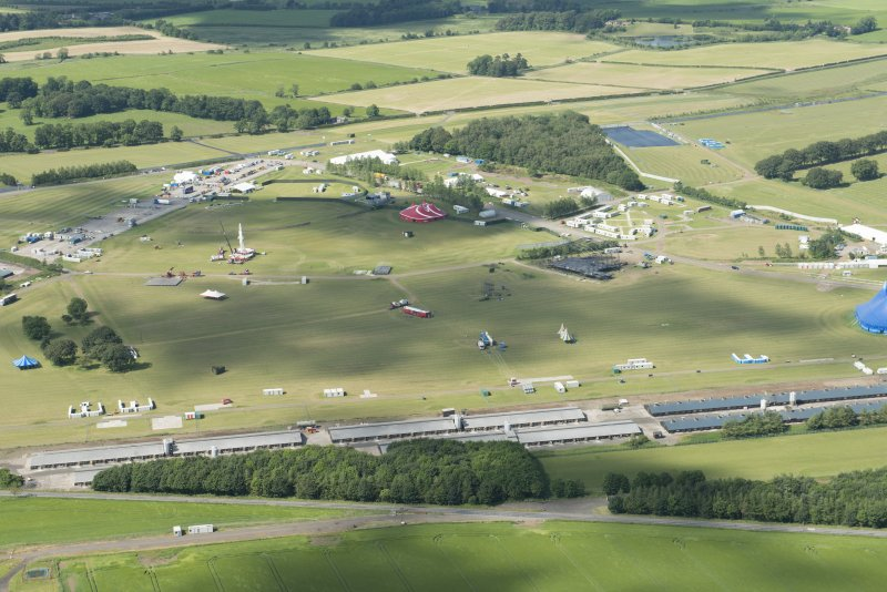 Oblique aerial view of Balado showing T in the Park, looking NNE.