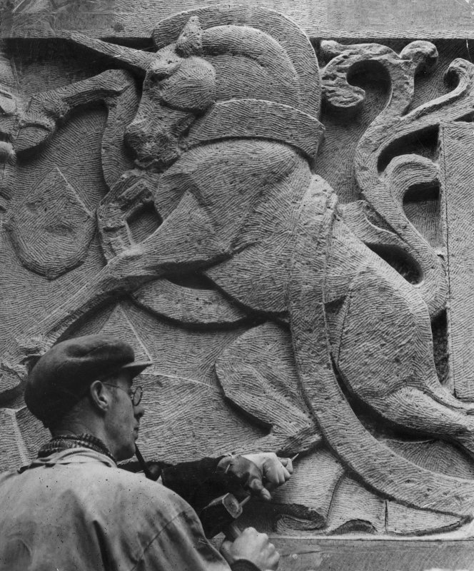 View of John Marshall sculpting unicorn relief on St Andrew's House, Edinburgh.