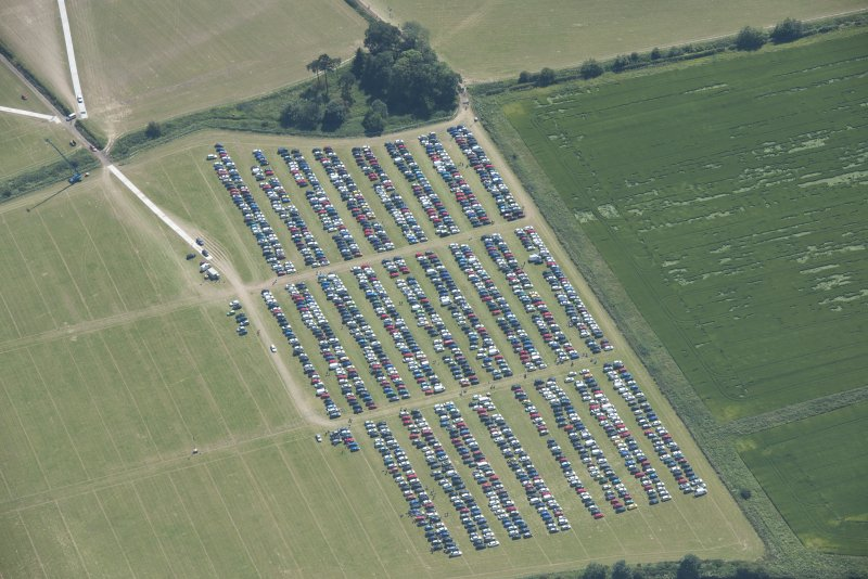 Oblique aerial view of the off-site car parking for T in the Park, looking NNW.