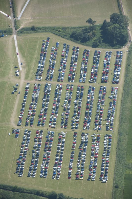 Oblique aerial view of the off-site car parking for T in the Park, looking NW.