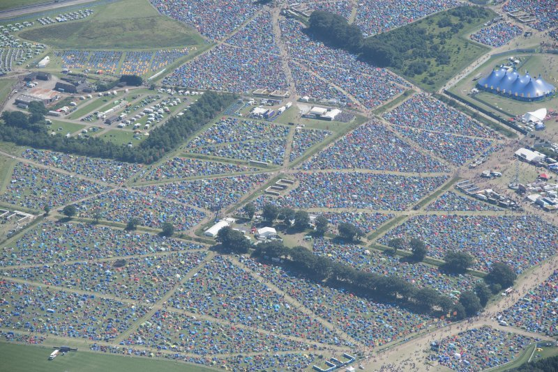Oblique aerial view of camping at T in the Park, looking SE.