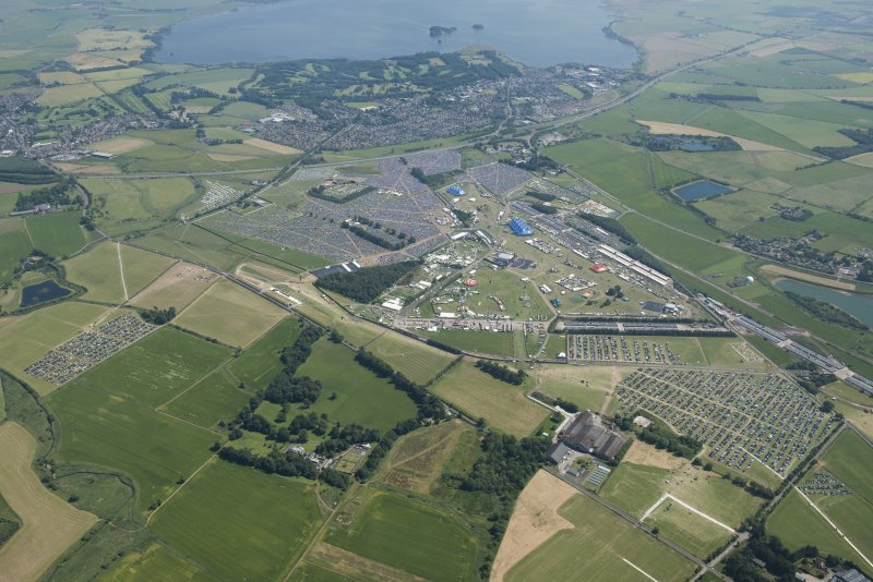 General oblique aerial view of T in the Park, looking SE.