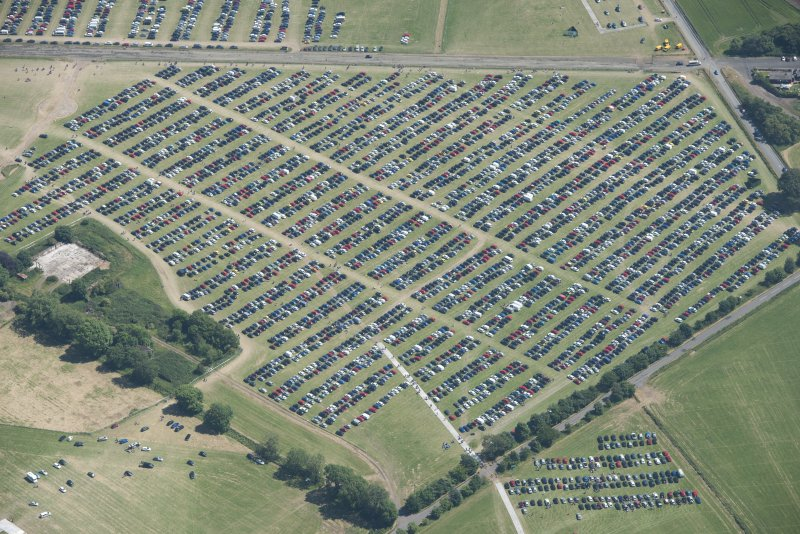 Oblique aerial view of car parking at T in the Park, looking SE.