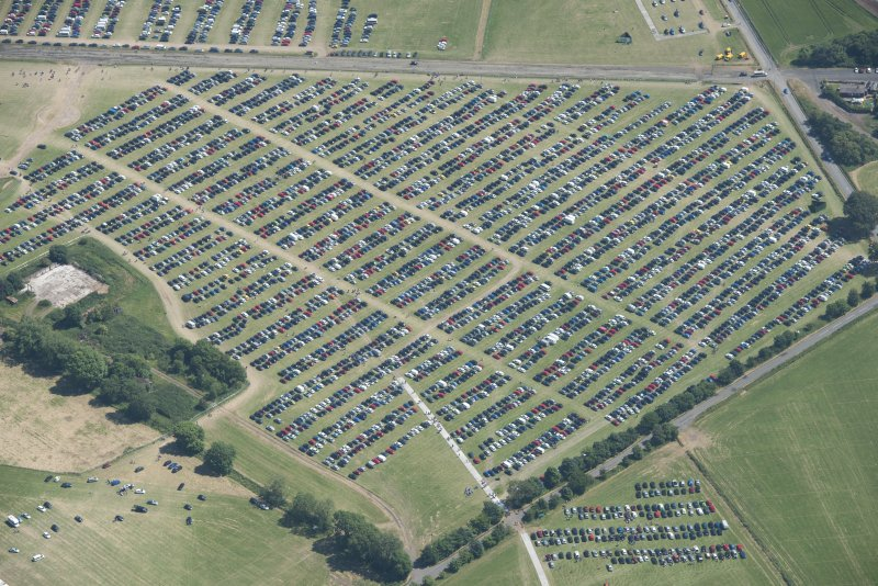 Oblique aerial view of car parking at T in the Park, looking ESE.