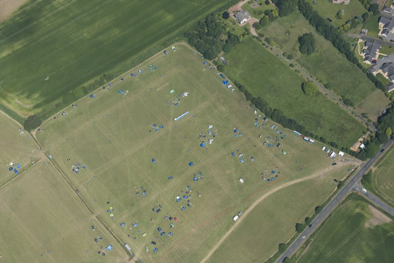 Oblique aerial view of a camp site at T in the Park, looking NE.