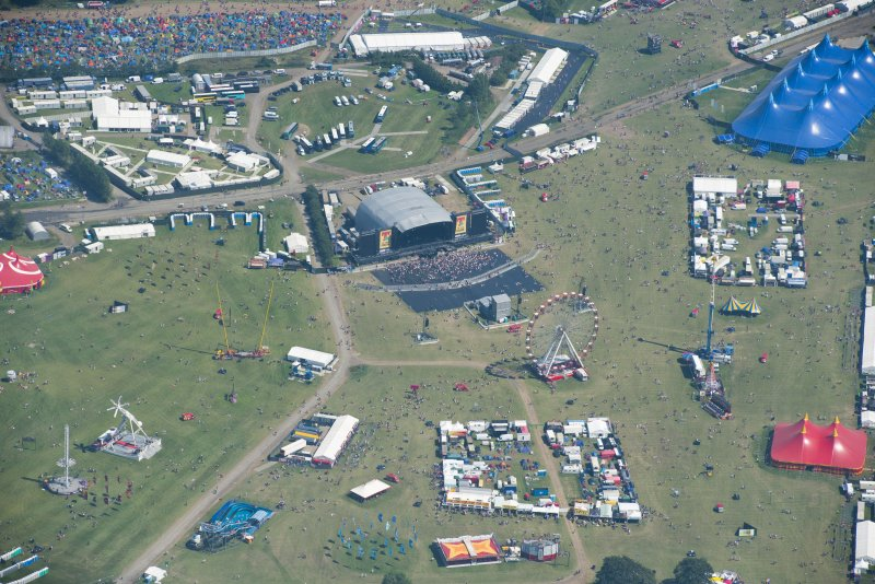 Oblique aerial view of T in the Park centred on the Main Stage, looking E.