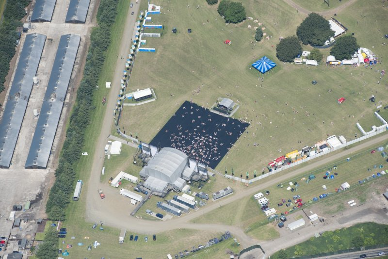Oblique aerial view of T in the Park centred on the Radio 1 Stage, looking NNE.