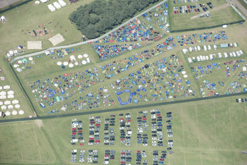 Oblique aerial view of camping at T in the Park, looking N.
