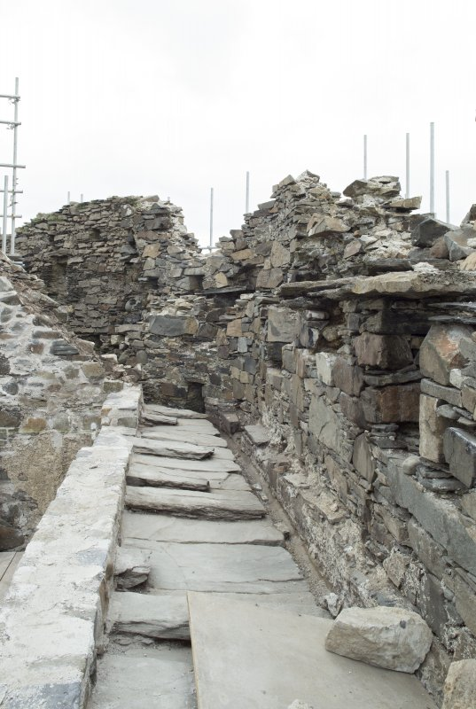 Lower parapet level, north side, view from east showing stone slabs interleaved over wall head