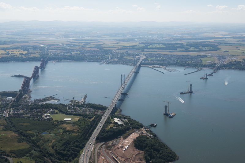 General oblique aerial view of the Forth Road and Rail Bridges and the construction of the Queensferry Crossing, looking SSE.