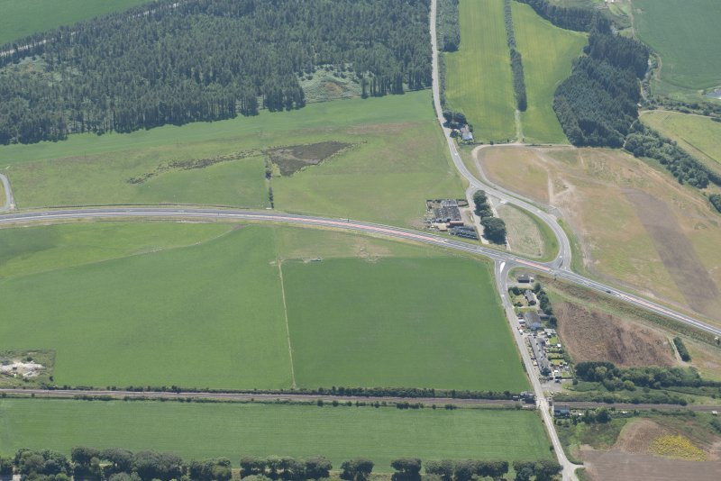 Oblique aerial view of the Dunragit bypass with Droughdool mound beyond, looking SSW.
