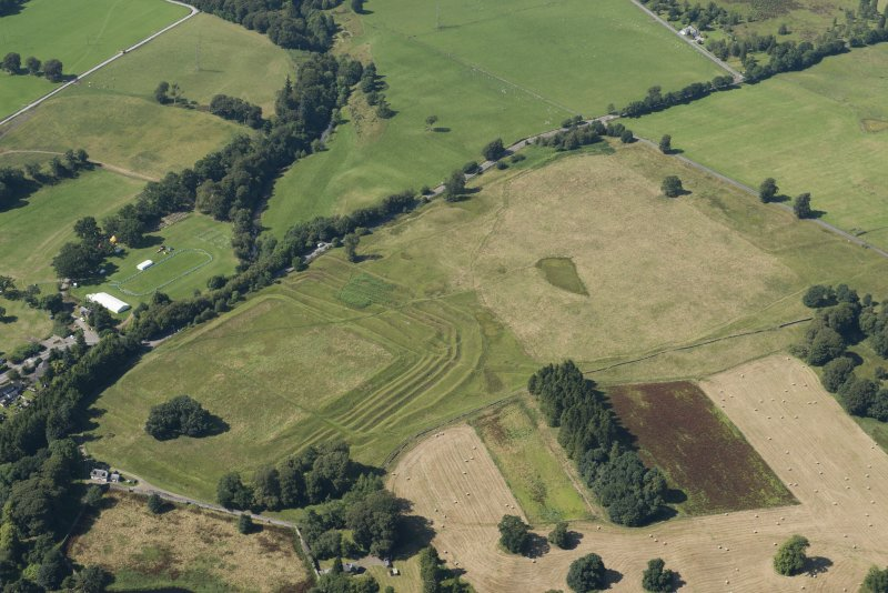 Oblique aerial view of Ardoch Roman fort, looking NNW.