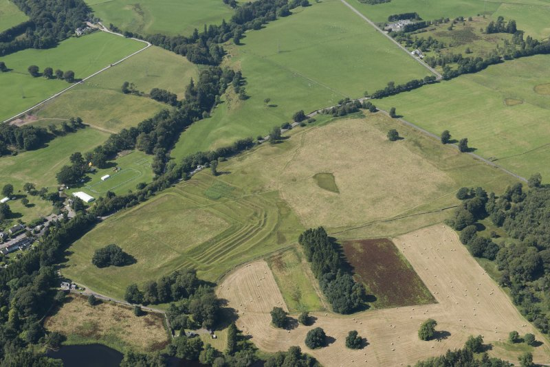 Oblique aerial view of Ardoch Roman fort, looking NW.