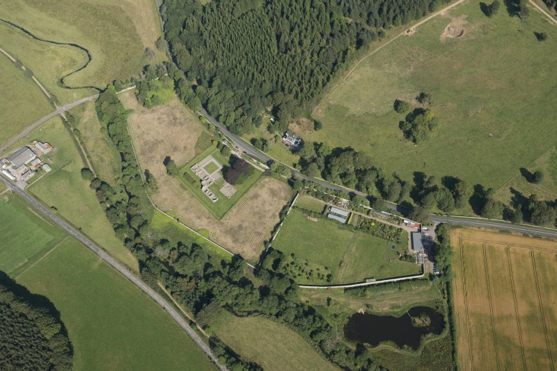 Oblique aerial view of Deer Abbey and walled garden, looking NW.