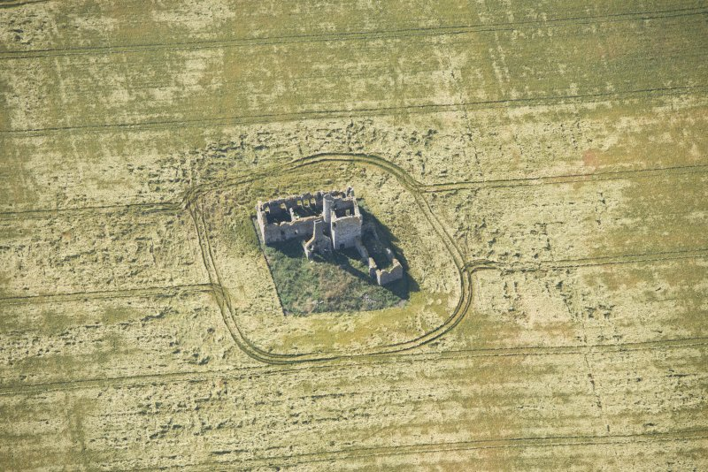 Oblique aerial view of Castle of Pittulie, looking SSE.