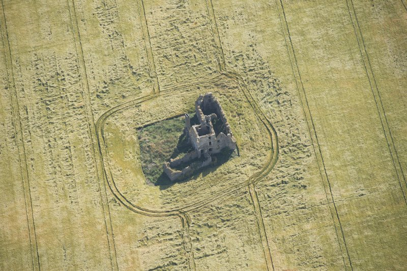 Oblique aerial view of Castle of Pittulie, looking E.