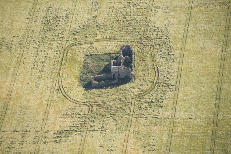 Oblique aerial view of Castle of Pittulie, looking ENE.