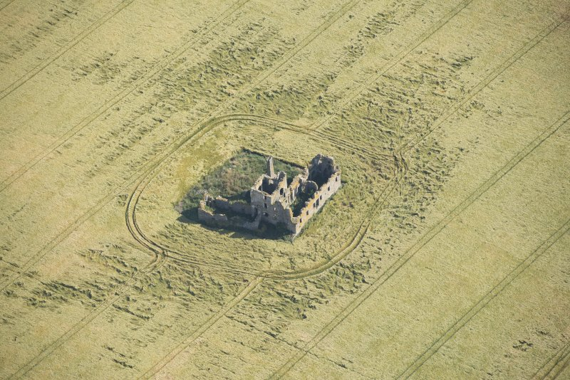 Oblique aerial view of Castle of Pittulie, looking NE.