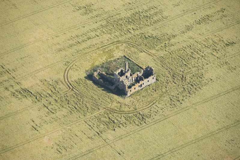 Oblique aerial view of Castle of Pittulie, looking NNE.