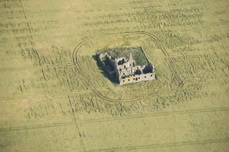 Oblique aerial view of Castle of Pittulie, looking N.