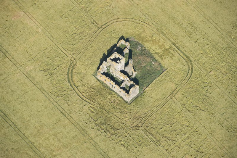Oblique aerial view of Castle of Pittulie, looking NW.