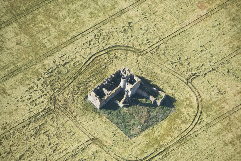 Oblique aerial view of Castle of Pittulie, looking SW.